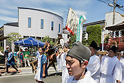 Soma, Fukushima prefecture, July 25 2015 - Kazuhiko ITO in the riding his horse during the parade on the streets of Minami-Soma duroing Nomaoi.<br /> The Soma nomaoi is said to be a 1000-year-old traditional festival. It was held in 2011, a few months after the nuclear disaster, but only a few local horses were available.