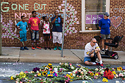 CHARLOTTESVILLE, USA - August 16: People stop to pay their respects at a memorial for Heather Heyer and the other victims at the intersection where James Alex Fields Jr., a White Supremacist, drove his car into a crowd of counter-protestors, killing Heyer and wounding 19 others last Saturday, in Charlottesville, Va., USA on August 16, 2017.