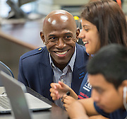 Former NFL great Donald Driver talks with a student during the Houston launch of the Character Playbook, a joint initiative of the NFL and the United Way Worldwide at Pilgrim Academy, February 3, 2017.