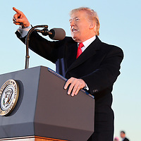 President Donald Trump speaks to Tupelo residents and supporters Monday afternoon at the Tupelo Regional Airport.