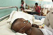 Ghana: 25 April 2012, Isiah Anane, 9 months old, who suffers from pneumonia, breathes oxygen from a tank as he lies on a bed at the Princess Marie Louise Children's hospital in Accra. The GAVI Alliance is a public-private partnership that brings together developing country and donor governments, WHO, UNICEF, the World Bank, the vaccine industry in both industrialised and developing countries, research and technical agencies, civil society, the Bill & Melinda Gates Foundation and other private philanthropists.  Set up in 2000 as the Global Alliance for Vaccines and Immunisation, GAVI's mission is to save children's lives and protect people's health by increasing access to immunisation in the world's poorest countries.