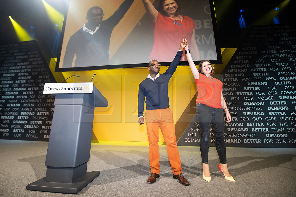 © Licensed to London News Pictures . 14/09/2019. Bournemouth, UK. Former Conservative Party MP SAM GYIMAH defects to the Lib Dems and is welcomed by party leader JO SWINSON , on the evening of the first day of the Liberal Democrat Party Conference at the Bournemouth International Centre . Photo credit: Joel Goodman/LNP