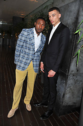 Left to right, TOLU ADEKO founder of The Hub magazine DUDLEY O'SHAUGHNESSY at a tea party organised by The Hub Magazine in aid of charity Kids Company held at The Sanderson, Berners Street, London on 2nd May 2012.