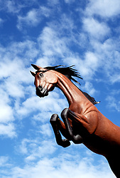 """New Mexico: Ruidoso, """"Free Spirits"""", horse sculpture, sculptor Dave McGary ,  Photo: nmhors103.Photo copyright Lee Foster, www.fostertravel.com, 510/549-2202, lee@fostertravel.com"""