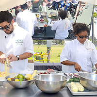 "Executive Chef from The Wilshire and contestant on Bravo's Top Chef Season 9,  Nyesha Arrington and Executive Chef of  Michael's, John-Carlos Kuramoto, face-off in the Santa Monica Farmers Market ""Chef Challenge"" cooking competition during the 21st annual Santa Monica Festival at Clover Park on Saturday, May 19, 2012. Chef  Arrington prepared a shaved asparagus salad and Chef Kuramoto prepared an arugula and avocado salad. Chef  Arrington won the cooking competition."