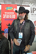 Manhattan, New York City, New York, USA. October 10, 2015. MATTHEW FILLBACH, who, along with his brother Shawn, does the artwork and writing for the superhero graphic novel Captain Freebird: American Prayer is at the Artist Alley at the 10th Annual New York Comic Con. NYCC 2015 is expected to be the biggest one ever, with over 160,000 attending during the 4 day ReedPOP event, from October 8 through Oct 11, at Javits Center in Manhattan