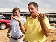 Tom Dittmer (right) talks as his son, Ben Dittmer, looks on at Grandview Farms in Eldridge, Iowa on Thursday August 9, 2012.