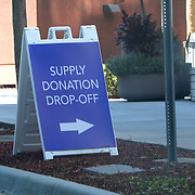 A donation drop off sign is placed by an Advent Health Hospital Campus parking garage on Saturday, March 28, 2020 in Orlando, Florida. (Alex Menendez via AP)
