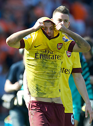 BLACKPOOL, ENGLAND - Sunday, April 10, 2011: Arsenal's Jack Wilshere removes his shirt after the 3-1 victory over Blackpool during the Premiership match at Bloomfield Road. (Photo by David Rawcliffe/Propaganda)