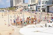 People use the public fitness equipment on Gordon Beach, Tel Aviv, Israel