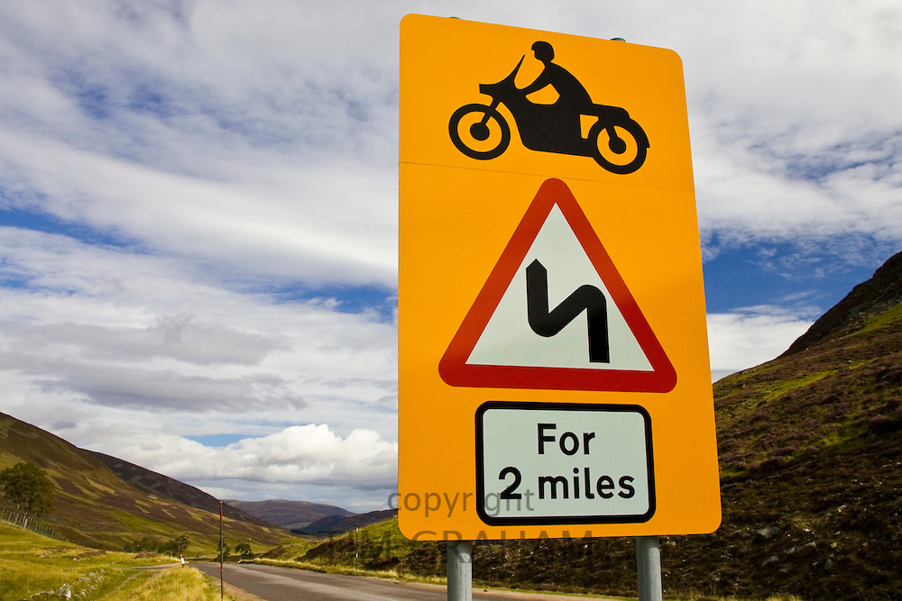 Roadsign warning of dangerous bends in Glenshee, Scotland