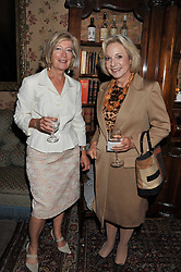 Left to right, ANNE SINGER and LITA LIVANOS at a lunch in aid of the charity Kids Company held at Mark's Club, 46 Charles Street, London on 3rd October 2011.