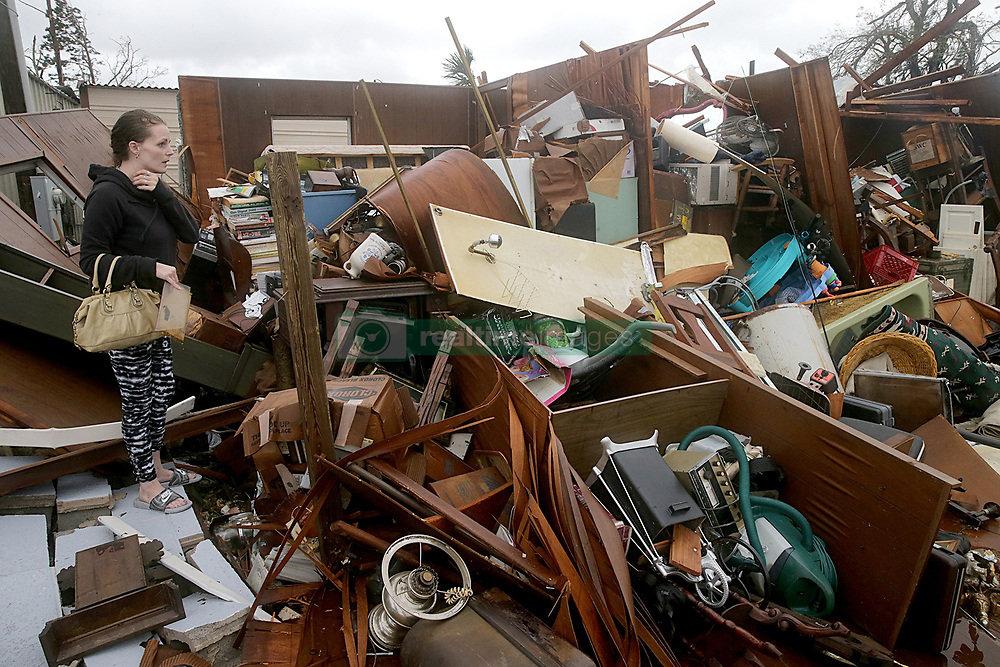 October 10, 2018 - Panama City, Florida, U.S. - HALEY NELSON inspects damages to her family properties after Hurricane Michael made landfall along Florida's Panhandle on Wednesday. Hurricane Michael stormed in as a powerful Category 4 storm with maximum sustained winds at 155 mph. (Credit Image: © Pedro Portal/Miami Herald/TNS via ZUMA Wire)