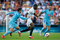 August 20, 2018 - Valencia, Valencia, Spain - Geoffrey Kondogbia (C) of Valencia CF competes for the ball with Antoine Griezmann (L) and Saul Niguez of Atletico de Madrid during the La Liga match between Valencia CF and Club Atletico de Madrid at Mestalla on August 20, 2018 in Valencia, Spain  (Credit Image: © David Aliaga/NurPhoto via ZUMA Press)