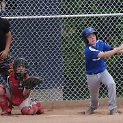 A young batter hits a home run during the Norwalk Little League baseball competition at Broad River Fields,  Norwalk, Connecticut. USA. Photo Tim Clayton