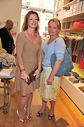Left to right, TIFFANIE DARKE and ? at a ladies lunch in aid of Mothers4Children hosted by Carmelbabyandchild at 259 Pavillion Road, London SW1 on 30th June 2011.