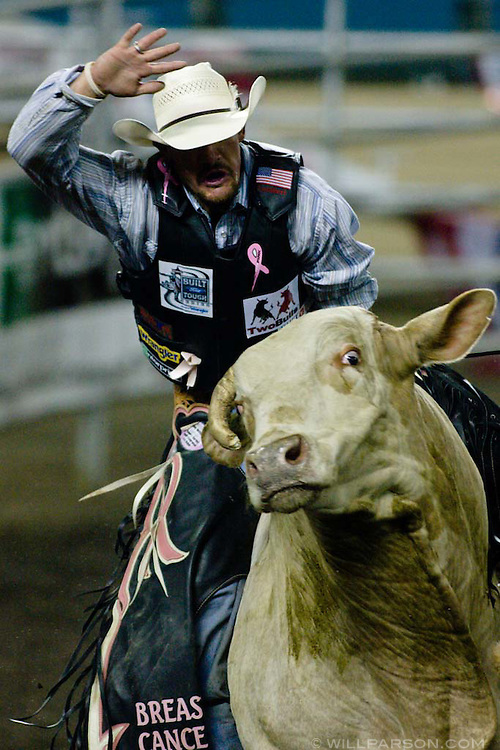 Tony Mendes of Pueblo, CO rides the bull Hawaiian Style for 83.5 points during the PBR rodeo at the Del Mar Fairgrounds in Del Mar, California on July 26th, 2008.  Mendes was the Saturday champion after being the only rider to make eight seconds in the Short Go.