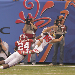 2 January 2009: Utah wide receiver David Reed (16) makes an acrobatic catch over Alabama cornerback Marquis Johnson (24) during the 75th annual All State Sugar Bowl  between the Utah Utes and the Alabama Crimson Tide at the Louisiana Superdome in New Orleans, LA.