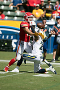 Kansas City Chiefs tight end Travis Kelce (87) tries to catch an incomplete third quarter pass broken up by Los Angeles Chargers cornerback Trevor Williams (24) during the 2018 regular season week 1 NFL football game against the Los Angeles Chargers on Sunday, Sept. 9, 2018 in Carson, Calif. The Chiefs won the game 38-28. (©Paul Anthony Spinelli)
