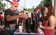 Folks from Artigue's Market sell drinks to people gathering in Abita Springs Park before fireworks on July 2, 2017