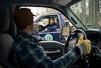 Neil Cederberg and Martin Carney drive loaded trucks back and forth off Squam Lake delivering ice blocks to two ice houses at Rockywold Deephaven Camp during their annual ice harvest on Tuesday.  ©2018 Karen Bobotas Photographer