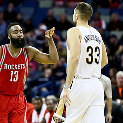 Jan 25, 2016; New Orleans, LA, USA; Houston Rockets guard James Harden (13) reacts after scoring against New Orleans Pelicans forward Ryan Anderson (33) during the fourth quarter of a game at the Smoothie King Center. The Rockets defeated the Pelicans 112-111. Mandatory Credit: Derick E. Hingle-USA TODAY Sports