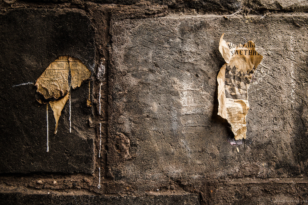 Old soviet newspaper bits still glued to a building wall in Gyumri. Armenia