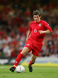 CARDIFF, WALES - Wednesday, September 8, 2004: Wales' John Oster in action against Northern Ireland during the Group Six World Cup Qualifier at the Millennium Stadium. (Pic by David Rawcliffe/Propaganda)