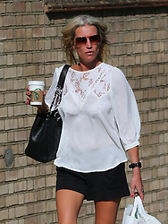 Denise Van Outen wearing a white lace blouse, short black shorts and red ankle boots out and about in London, UK. 09/08/2013<br />BYLINE MUST READ : JAMESY/GOTCHA IMAGES<br /><br />Copyright by © Gotcha Images Ltd. All rights reserved.<br />Usage of this image is conditional upon the acceptance <br />of Gotcha Images Ltd, terms and conditions available at<br />www.gotchaimages.com
