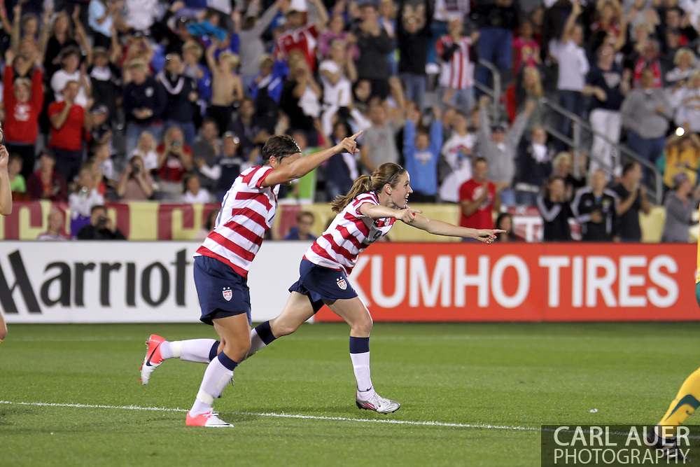 September 19, 2012 Commerce City, CO.  USA m Heather O'Reilly (9) and f Abby Wambach (14) celebrate after O'Reilly scored the first goal of the Soccer Match between the USA Women's National Team and the Women's Australian team at Dick's Sporting Goods Park in Commerce City, Colorado