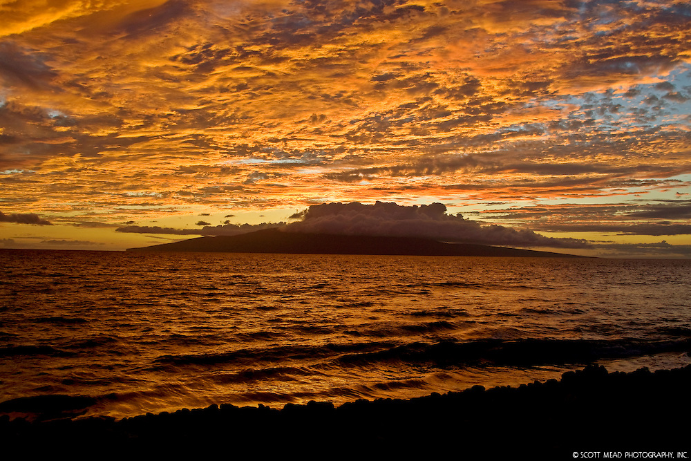 Clouds and surf at twilight with view of Molokai, Maui County, Hawaii
