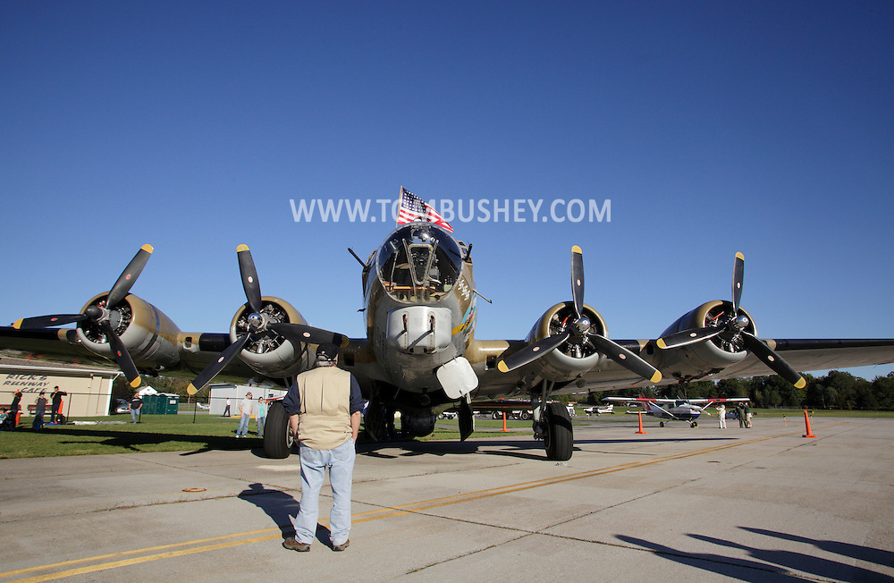 Montgomery, New York -  A man looks at a B-17 Flying Fortress Bomber from Collings Foundation on display as part of the Wings of Freedom Tour at Orange County Airport on Oct. 2, 2010.