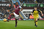 Aston Villa midfielder Joshua Onomah (18) and Burton Albion midfielder Jacob Davenport (19) during the EFL Sky Bet Championship match between Aston Villa and Burton Albion at Villa Park, Birmingham, England on 3 February 2018. Picture by Richard Holmes.