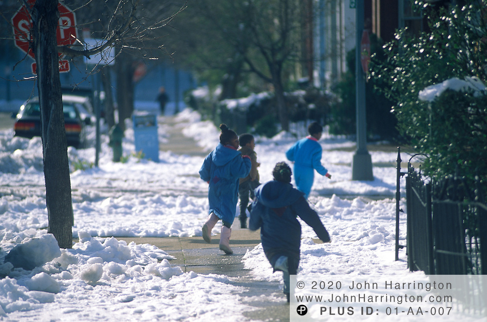 Children enjoy the day off and play in the snow in Washington DC.