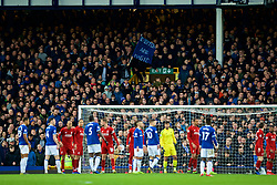 "LIVERPOOL, ENGLAND - Sunday, March 3, 2019: An Everton supporter with a banner ""Everton are magic"" during the FA Premier League match between Everton FC and Liverpool FC, the 233rd Merseyside Derby, at Goodison Park. (Pic by Paul Greenwood/Propaganda)"