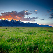 Blowing clouds and wind at sunset in Grand Teton National Park Wyoming.