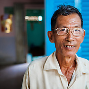CAPTION: Mai Van Cho standing outside his house. LOCATION: An Binh Ward, Can Tho, Vietnam. INDIVIDUAL(S) PHOTOGRAPHED: Mai Can Cho.