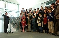 24 OCT 2003, BERLIN/GERMANY:<br /> Gerhard Schröder (L), SPD, Bundeskanzler, spricht waehrend einem Empfang zu Angehoerigen von im Ausland stationierten Bundeswehr Soldaten,mitten in der Gruppe: und Peter Struck, SPD, Bundesverteidigungsminister, Bundeskanzleramt<br /> IMAGE: 20031024-02-013<br /> KEYWORDS: Gerhard Schröder