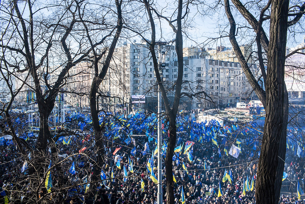 KIEV, UKRAINE - DECEMBER 14: A large crowd of pro-government demonstrators gathers for a rally on December 14, 2013 in Kiev, Ukraine. Thousands of people have been protesting against the government since a decision by Ukrainian president Viktor Yanukovych to suspend a trade and partnership agreement with the European Union in favor of incentives from Russia. (Photo by Brendan Hoffman/Getty Images) *** Local Caption ***