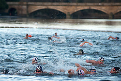 Serpentine Christmas Day Swimming. Members of the Serpentine Swimming club take part in the annual Peter Pan Cup - Christmas Day race in the  Serpentine lake.  The swimmers compete in a 100 yard swimming race which has taken place on Christmas Day every year since 1864.The Serpentine Lake, London, United Kingdom. Wednesday, 25th December 2013. Picture by Peter Kollanyi / i-Images