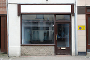 Unmarked vacated shop window, Parsonage Street, Dursley, Gloucestershire .Recession 2010: Parsonage Street, Dursley, Gloucestershire shops closed due to economic downturn.