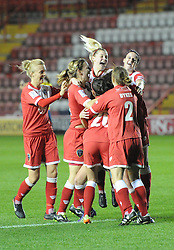 Players celebrate Bristol Academy's win over FC Barcelona in UEFA Women's Champions League tie at Ashton Gate - Photo mandatory by-line: Paul Knight/JMP - Mobile: 07966 386802 - 13/11/2014 - SPORT - Football - Bristol - Ashton Gate Stadium - Bristol Academy v FC Barcelona - UEFA Women's Champions League