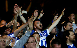 Brighton & Hove Albion fans celebrate the win over Queens Park Rangers - Mandatory by-line: Robbie Stephenson/JMP - 07/04/2017 - FOOTBALL - Loftus Road - Queens Park Rangers, England - Queens Park Rangers v Brighton and Hove Albion - Sky Bet Championship
