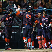 16 February 2018: San Diego State baseball opened up the season against UCSB at Tony Gwynn Stadium. San Diego State outfielder Chad Bible (23) is congratulated by teammates after scoring on a past ball in the second inning. The Aztecs beat the Gauchos 9-1. <br /> More game action at sdsuaztecphotos.com