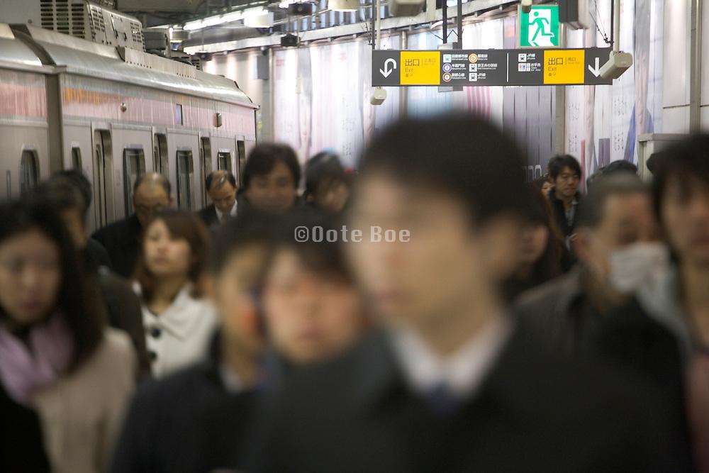 Tokyo Japan Shibuya station with commuters