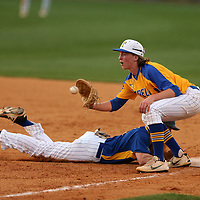 Oxford base runner Bo Gatlin dives back to first as Tupelo first baseman Hunter Elliott makes the catch. Gatlin was safe.