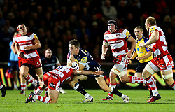 Matt Scott of Gloucester Rugby is tackled by Greig Laidlaw (capt) of Gloucester Rugby  - Mandatory by-line: Matt McNulty/JMP - 16/09/2016 - RUGBY - Heywood Road Stadium - Sale, England - Sale Sharks v Gloucester Rugby - Aviva Premiership