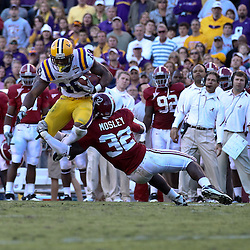 November 6, 2010; Baton Rouge, LA, USA;  LSU Tigers running back Richard Murphy (18) is tackled by Alabama Crimson Tide linebacker C.J. Mosley (32) during the second half at Tiger Stadium. LSU defeated Alabama 24-21.  Mandatory Credit: Derick E. Hingle
