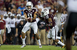 Texas A&M quarterback Kellen Mond (11) hands the ball off to running back Trayveon Williams (5) during the first quarter of an NCAA college football game against South Carolina Saturday, Sept. 30, 2017, in College Station, Texas. (AP Photo/Sam Craft)