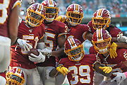 Sunday, October 13, 2019; Miami Gardens, FL USA;  Washington Redskins  linebacker Shaun Dion Hamilton (51) strong safety Montae Nicholson (35) cornerback Jimmy Moreland (32) cornerback Josh Norman (24) Washington Redskins linebacker Cole Holcomb (55) and defensive back Jeremy Reaves (39) celebrate an interception during an NFL game against the Dolphins at Hard Rock Stadium. The Redskins beat the Dolphins 17-16. (Kim Hukari/Image of Sport)
